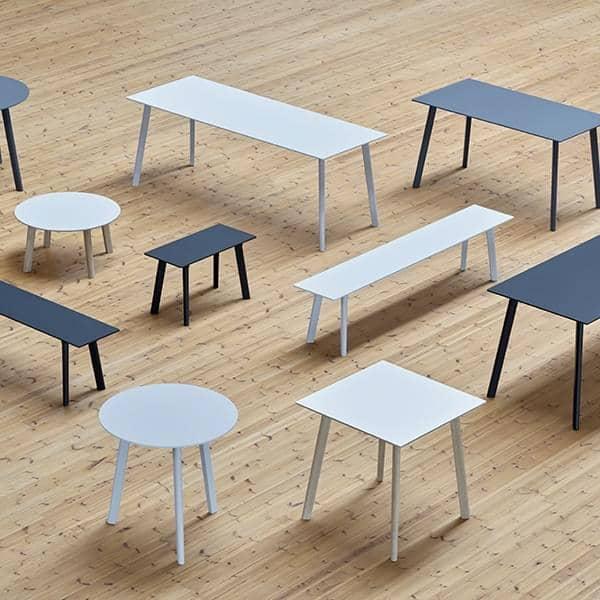 La colección de mesas de comedor COPENHAGUE CPH DEUX en madera maciza y  madera contrachapada, por Ronan y Erwan Bouroullec